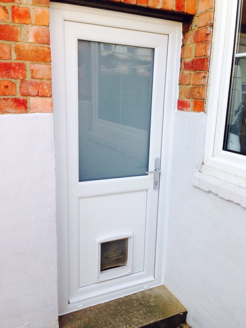 Composite front door and back door in st james for Upvc french doors with cat flap