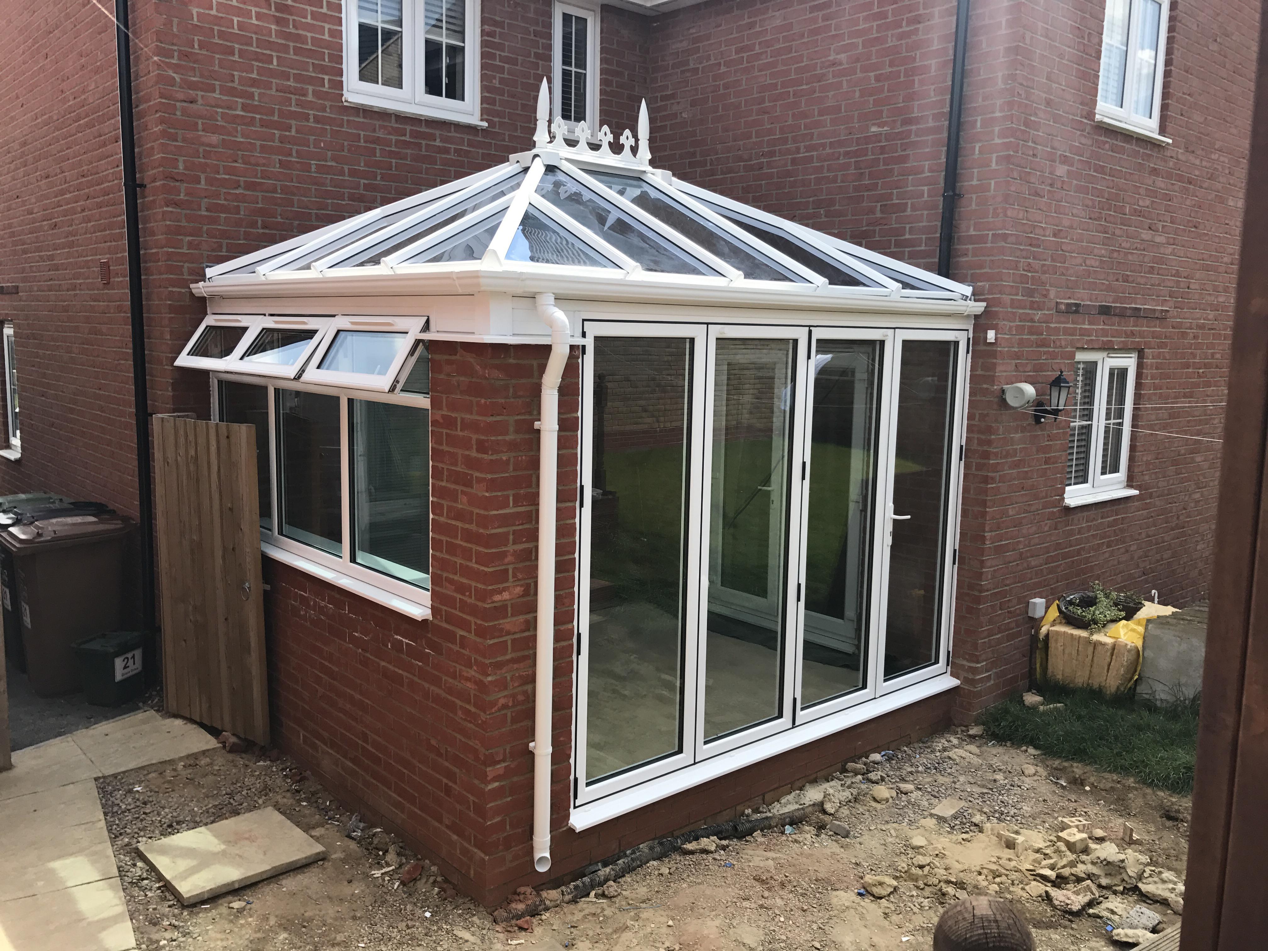 Conservatory with bi-fold doors. | Neil Amos Windows
